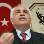 Turkish Workers Party (IP) leader Dogu Perincek gestures in fron